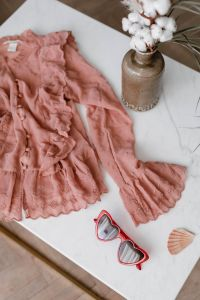 Kaboompics - Blouse in pale pink colour made of thin chiffon with frills & heart shaped sunglasses