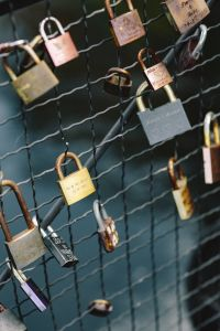 Kaboompics - Love locks hanging on a fence on a bridge