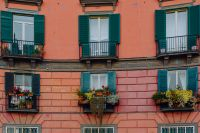 The facade of an orange tenement house in Naples