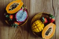 Kaboompics - Exotic fruits on a wooden table