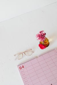 Kaboompics - Pink calendar with planner - flower - glasses