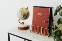 Kaboompics - Planner on The White Marble Table, White Background, Pilea, Globe