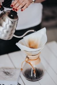Kaboompics - Woman pouring water in Chemex filter coffee maker