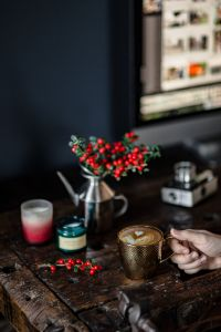 Cup of coffee, Fresh Holly and Candles