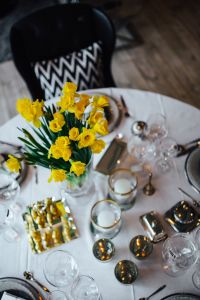 Kaboompics - Table decorations with golden motifs and yellow flowers