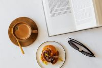 Kaboompics - Coffee - book - cinnamon roll - sunglasses