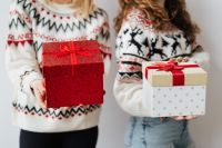 Women with Gifts Wearing Christmas Sweater