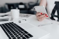 Kaboompics - Businesswoman uses her iPhone mobile at her desk