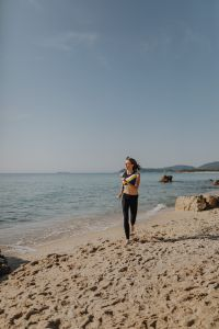 Kaboompics - Woman jogging on the beach - running