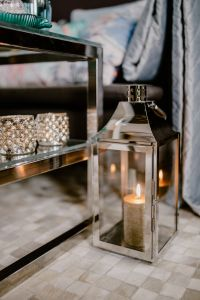Kaboompics - Modern living room with a candles and silver lantern