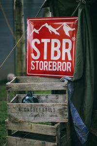 Kaboompics - Red sign and wooden crates in a garden