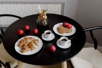 Kaboompics - Breakfast served with coffee, croissants, cookies and plums