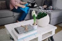 Kaboompics - Small wooden table with a potted plant and a grey wallet