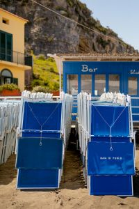 Kaboompics - Blue hotel loungers on the beach, Baia di Puolo Hotel