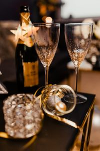 Kaboompics - New Year's Eve party - open bottle of champagne and glasses