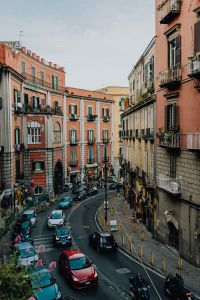 Street with cars and old tenement houses in Naples