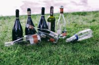 Kaboompics - Empty wine bottles on the grass