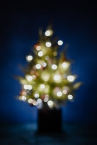 Kaboompics - A blurred Christmas tree on a navy blue background