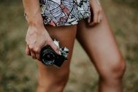 Kaboompics - Woman in a dress with a camera