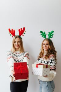 Kaboompics - Women with Christmas Gift wearing sweater and reindeer horns on head