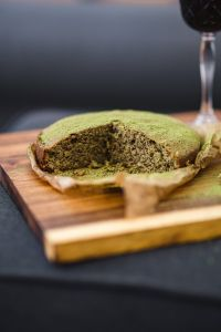 Kaboompics - Delicious homemade matcha cake on a wooden board