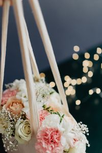 Bouquet of flowers in a bag with some fairy lights