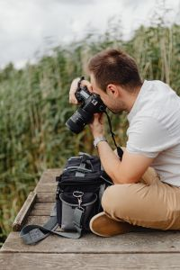 Photographer holding a DSLR camera