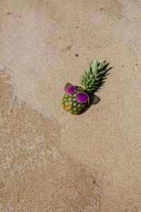 Kaboompics - Pineapple with sunglasses on the beach
