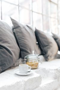 Kaboompics - Morning coffee with a jar of brown sugar with pillows