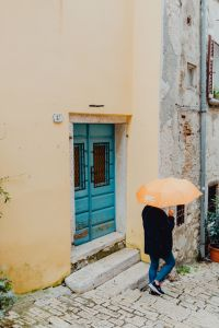 Kaboompics - Woman with a yellow umbrella, Rovinj, Croatia