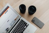 Kaboompics - Laptop, phone mi photo lenses on desk