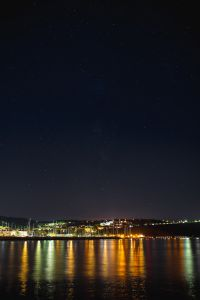 Starry sky at night over the marina, Izola, Slovenia