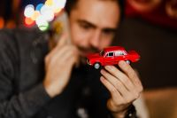 A handsome man with Christmas presents - toy car
