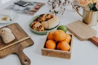 Kaboompics - Orange - croissant - cutting board ona table