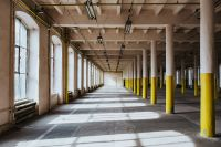 Kaboompics - Interior of an abandoned building hall with yellow pillars