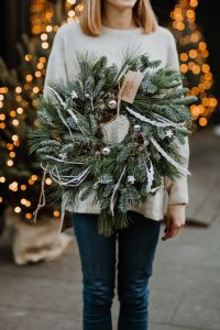 Kaboompics - The woman is holding a Christmas wreath in her hands