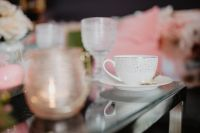 Cup and glass dishware on the glass table