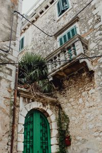 Green door of an old building in Rovinj, Croatia