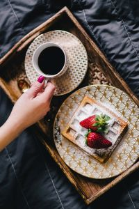 Saffle with strawberries and cup of coffee