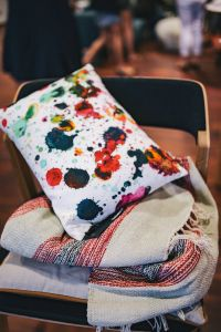 Kaboompics - Pillow with colourful dots on a chair