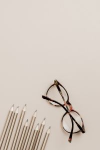 Copy space - pencils - glasses - flat lay