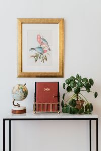Planner on The White Marble Table, White Background, Pilea, Globe, Painting on the Wall