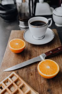 Kaboompics - Cup of coffee, knife, waffle, oranges