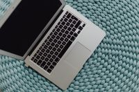 MacBook Laptop on a blue pouf