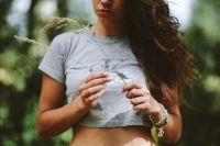 Kaboompics - Woman in a grey crop top shirt holding wheat