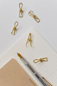 Kaboompics - Fountain pen, clips and notebooks on a white desk
