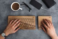 Kaboompics - Young man typing on the wooden keyboard