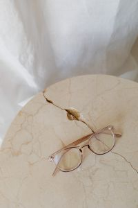 Kaboompics - Corrective glasses lie on a marble table