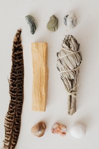 Kaboompics - Sage - Palo Santo Wood - feather - stones
