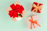 Kaboompics - Christmas gifts on a pastel green background